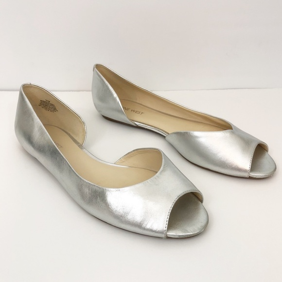 a19d134304c2 ... Silver Leather Open Toe Flat. M 5bccce8b9fe4868734ea9d4a